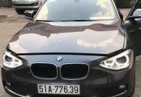 Cần bán xe BMW 1 Series 116i năm 2014, màu xám, xe nhập chính chủ giá 920 triệu tại Tp.HCM