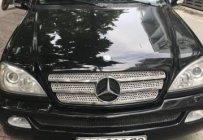 Cần bán xe Mercedes ML 320 đời 2003, màu đen, giá chỉ 315 triệu giá 315 triệu tại Tp.HCM