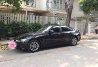 Chính chủ bán xe BMW 3 Series 320i sản xuất 2014, màu đen giá 865 triệu tại Tp.HCM