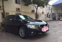 Bán BMW 3 Series 320i sản xuất năm 2013, màu đen, giá chỉ 850 triệu giá 850 triệu tại Tp.HCM