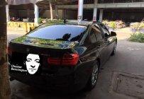 Cần bán xe BMW 3 Series 320i đời 2013, màu đen, xe nhập chính chủ giá 850 triệu tại Tp.HCM