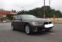 Cần bán BMW 320i đời 2012 màu nâu, giá tốt, xe đẹp hoàn hảo giá 835 triệu tại Hà Nội