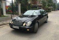 Bán Mercedes E200 sản xuất 2005, màu đen, nhập khẩu số sàn, 346tr giá 346 triệu tại Hà Nội