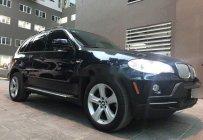Bán BMW X5 4.8 năm 2006, màu đen, xe nhập số tự động, giá 579tr giá 579 triệu tại Hà Nội