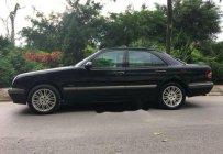 Bán xe Mercedes E 24 đời 2002, màu đen giá 140 triệu tại Hà Nội