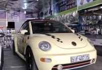 Bán xe Volkswagen New Beetle 2.0 AT mui xếp, đời 2003, màu kem giá 380 triệu tại Tp.HCM