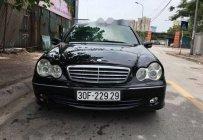 Bán Mercedes C180 đời 2005, màu đen số tự động  giá 260 triệu tại Hà Nội