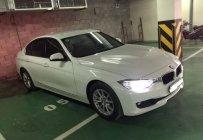 Cần bán gấp BMW 3 Series 320i sản xuất 2015, màu trắng giá 980 triệu tại Tp.HCM