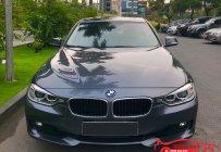 Chính chủ bán BMW 320i model 2014, màu nòng súng giá 865 triệu tại Hà Nội