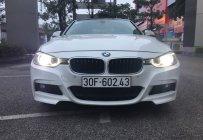 Bán xe BMW 320i màu trắng giá 825 triệu tại Hà Nội