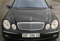 Bán ô tô Mercedes E240 sản xuất 2002, màu đen, giá chỉ 280 triệu giá 280 triệu tại Tp.HCM