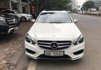 Bán Mercedes E250 AMG 2015, màu trắng giá 1 tỷ 450 tr tại Hà Nội