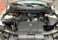 Bán BMW 3 Series 320i sản xuất 2009, màu trắng, nhập khẩu nguyên chiếc giá 450 triệu tại Tp.HCM