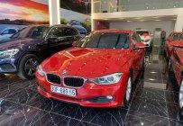 BMW 3 Series 320i đời 2014 màu đỏ, nội thất kem giá 875 triệu tại Hà Nội