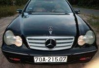 Bán xe Mercedes C200 2002, màu đen, số sàn giá 160 triệu tại Tp.HCM