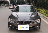 Cần bán lại xe BMW 3 Series 320i đời 2012, màu nâu, nhập khẩu nguyên chiếc   giá 768 triệu tại Tp.HCM