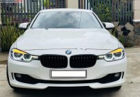 Bán BMW 3 Series 320i sản xuất 2014, màu trắng, nhập khẩu giá 950 triệu tại Tp.HCM