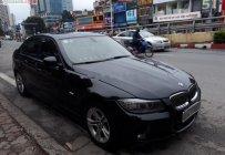 Cần bán BMW 320i 2010, màu đen, xe nhập, số tự động giá 495 triệu tại Hà Nội