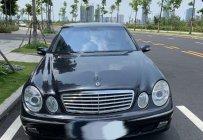 Cần bán gấp Mercedes E240 năm sản xuất 2003, màu đen, 255 triệu giá 255 triệu tại Tp.HCM