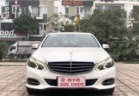 Bán Mercedes E200 năm sản xuất 2014, màu trắng, trả góp 75% giá 985 triệu tại Hà Nội